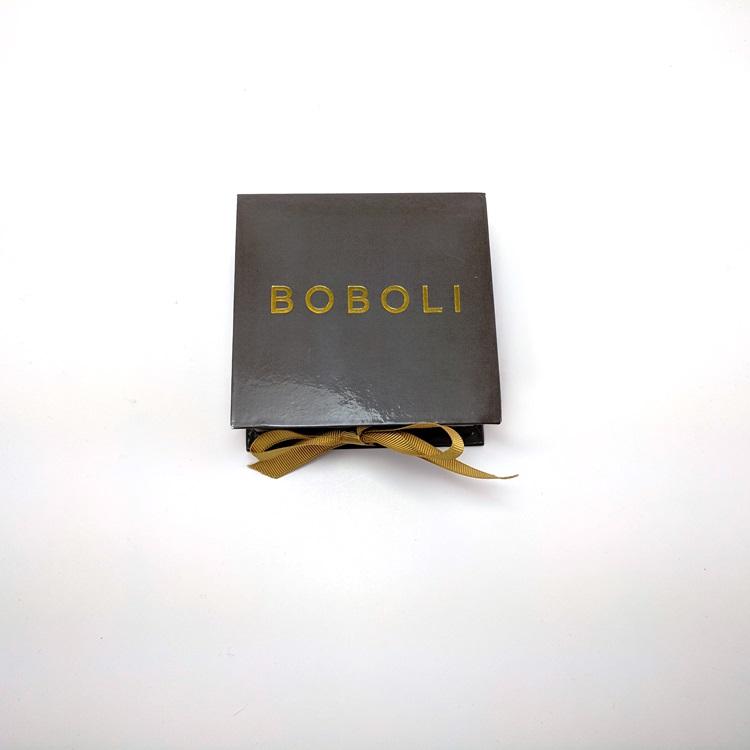 Rigid gloss lamination with gold hotstamp logo